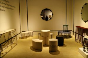 The tables in this gallery are made of white onyx and brass and turmaline and brass, some showing very abstract curves.