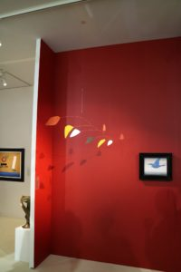 This untitled painted sheet metal and wire mobile is by artist Alexander Calder, 1960.