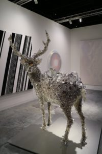 The PixCell-Red Deer by Kohei Nawa is covered in crystal balls of all sizes. There is actually a taxidermy deer beneath the glass orbs.
