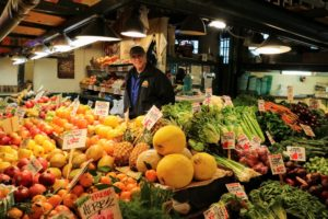 At Pike Place Market, Washington farmers sell their locally grown produce and specialty farm products to shoppers seven days a week, 363 days a year - closed only on Thanksgiving Day and Christmas Day. Here is just one of the many fruits and vegetables stands.