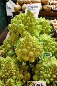 Do you know what this is? It's Romanesco broccoli, also known as Roman cauliflower, Broccolo Romanesco, Romanesque cauliflower or simply Romanesco, an edible flower bud of the species Brassica oleracea. It resembles a cauliflower, but is chartreuse in color and rich in vitamin-C, vitamin-K, dietary fiber, and carotenoids.