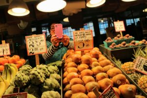 At this stall, the vendor took photos of me, as I took photos of the wonderfully fresh pears and artichokes.
