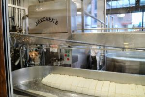 At Beecher's, the cheese is made in full view - from culturing the milk to cutting curds in enormous vats, the entire process of turning fresh milk into finished cheese is seen through large windows.
