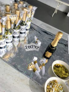 Bottles can be wrapped with the year on the front, or another fun party saying or sketch to make them more personal.