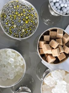 Specialty sugars and candies can be used to garnish champagne, wine or even sparkling water.