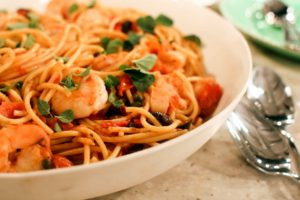 We also have two other dishes to show you - this is our spaghetti with tomatoes, olives and shrimp. Many of your favorite recipes that we've developed over the years have been adapted for Martha & Marley Spoon.