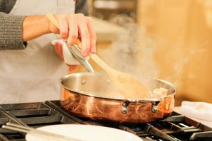 My Macy's copper set is on sale now at Macy's. The 10-piece collection includes a stockpot with lid, two saucepans with lids, a saute pan with a lid, and two frying pans - all with a manufacture's lifetime warranty. This is my three-point-five quart saute pan with lid. It has a wide flat bottom, and relatively tall, vertical sides.