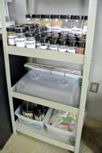 Seeds, seed sheets, humidity domes, and other cultivator accessories are stored neatly on shelves, where they can be kept handy and dry.