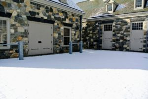 Here is the cobblestone courtyard down by the stable and in front of the carriage house where I keep my antique horse drawn carriages.