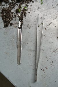 The tool on the left is great for seed starting - it's from Johnny's Selected Seeds. It's called a widger. It has a convex stainless steel blade that delicately separates seedlings. On the right, 10-inch gardening tweezers that are also helpful for handling young plants. http://www.johnnyseeds.com/p-9765-widger.aspx