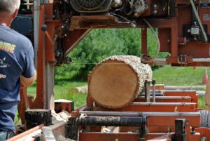 When milling larger trunks and logs, the wood is placed within the arms of the Wood-Mizer LT35 sawmill. Most mills are designed to hold logs at least eight feet long. http://woodmizer.com/us/