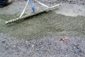 Using a rake makes it easy to level the gravel across the affected area.