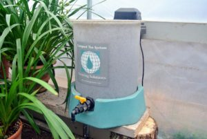 This is called the System10 by Growing Solutions. It's a 10-gallon compost tea model that's great for home gardens. It needs a sheltered location with a level surface and access to power and water, so we keep it in a small greenhouse next to the head house where I store various orchids and topiaries. http://www.growingsolutions.com