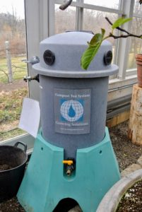 In my large vegetable greenhouse, we have a System25, a 25-gallon brewing unit also from Growing Solutions. Storing this here makes it easy to make bigger compost tea batches for use on all my citrus plants.