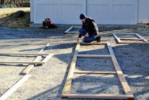 There's a lot of activity going on outside our workshop. My carpenter, John Kowalczyk, owner of JK Home Remodeling, is laying out the pieces for our new dog fence.