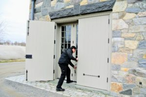 Charles checked all the doors on all the houses and outbuildings to make sure they were all closed and latched properly.