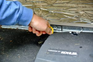 As in a car, there is a well-marked dip stick located just inside the top door.