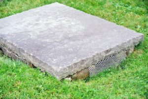 My catch basins are covered with bluestone caps. The grated drain openings are on the sides. If you have catch basins or storm drains on or near your home's property, be sure they are also checked and cleaned before a storm. Mine were recently cleaned, so all of them are in good order.