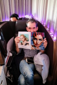Here is Kevin sitting in a business class seat aboard the Virgin Atlantic plane - the seats turn into long fully flat beds.