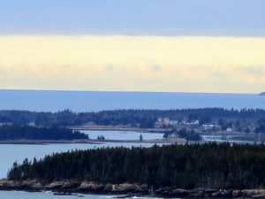 This is a view looking out from Terrace One. Sutton Island is in the forefront with Cranberry Island behind it. Sutton Island is a small, private island south of where I am on Mount Desert. One never tires of seeing this view.