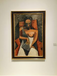 "This is a Pablo Picasso work called Femme a l'eventail Apres le bal or ""Woman with a Fan"", 1908."