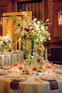 This table was done by Putnam & Putnam, a boutique floral design company.  (Photo by Chudleigh Weddings) http://putnamflowers.com/