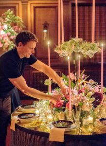 Lewis Miller, owner of Lewis Miller Design, adds the final touches to his table presentation - so pretty. (Photo by Chudleigh Weddings) http://lewismillerdesign.com
