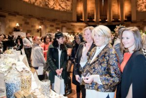 I enjoyed walking around the Gotham Hall Ballroom. A former bank built in 1922, Gotham Hall boasts a seven-story high glass ceiling, limestone Corinthian columns, granite walls, marble flooring, and an elliptical shaped event space. Here I am at the Hershey's Table.  (Photo by Chudleigh Weddings)