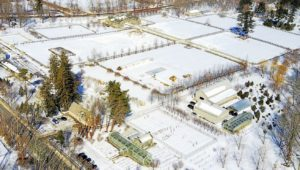 The drone then turned towards the Equipment Barn, to show this side of the main Greenhouse and the snow covered paddocks beyond.