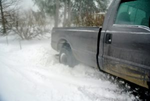 The back wheels of the truck are stuck in the deep snow - and just down the road from my Winter House.
