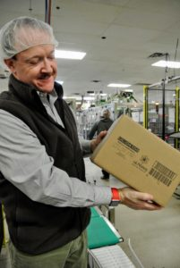"This is Kevin Steward, director of quality control for Barrie House, showing us a completed case of ULIVjava ""k-cups""."