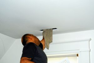 Using a rag, Ruben wipes down the inside walls of the vent area and checks for any unusual buildup.