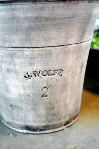 I've been using Guy Wolff pots for many years. Last autumn, Guy delivered many gorgeous new gray pots to my farm - he makes every one of them by hand. At the bottom side of each one, Guy stamps his name and the wet weight of the clay used. http://www.guywolff.com/
