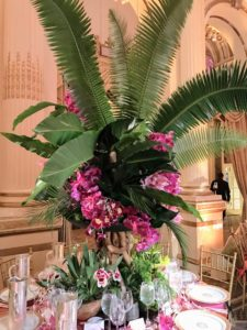 This centerpiece, with its bold use of bright pink and lush green foliage, was presented by Lewis Miller Design.
