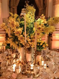 This pretty yellow orchid centerpiece was made by  The Mini Rose Co.