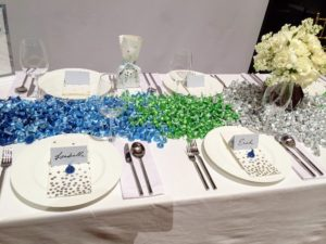 Here is a beautiful Hershey's table setting with lots and lots of delicious kisses.