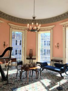 The house has six-thousand square feet of living space. The second floor drawing room was painted in apricot with ornate gray moldings covered with 24-karat gold leaf.