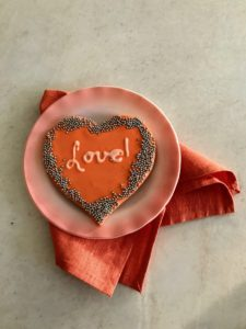 "I decided to style some of my cookies for photos - here is a single, large ""love"" cookie on plate."