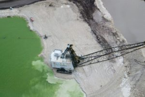 As we were flying over, I caught this crane mining for limestone. The crane  sweeps under the lake for limestone rock and then it is carried to another area where it is made into usable products.