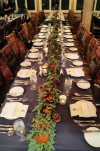 Pretty garlands were placed along the center of each table and accented with votive candles.