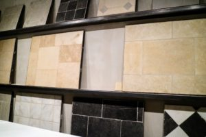 "Here is a display of Chateau Domingue's pocket-friendly, curated ""Bastide Collection"" line of newly-quarried, aged stone in marble, Belgian Blue, and selections of European limestone - the colors range from light and creamy to various shades of gray."