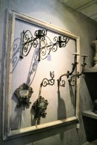 And a wall of antique French and Italian sconces.