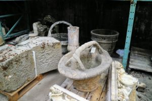 Here are more reclaimed stone elements, including stone baskets, iron urns, and decorative lintels and corbels.