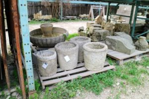 These are reclaimed European stone pieces, including an interesting and unusual set of garden urns.