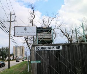 The Chateau Domingue street sign marks the expansive stone yard that houses all of its reclaimed building materials.