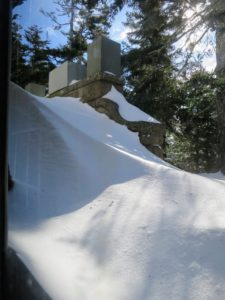 "It's nearly impossible to tell, but under this snow drift are the steps leading up to the main terrace. The ""Bedford Gray"" colored boxes protect some of my  outdoor urns."