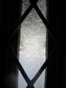 It takes a little longer for the frost to melt from the long, narrow leaded windows flanking my front door.