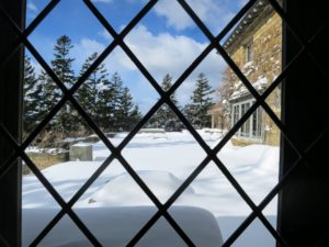 "This is one of my favorite views - through a leaded window in the dining room to the large ""iced"" terrace."