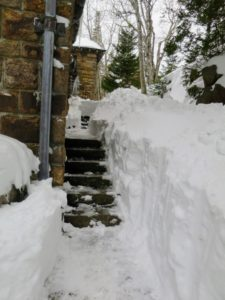Despite all the beauty, it's a lot of snow to shovel around the house - these steps run from the back porch to the front circle and driveway.