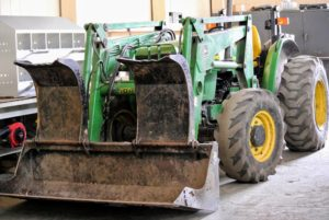 This John Deere tractor with its front loader, is used constantly around the farm to haul logs, planters, etc. It sits in the back of the Equipment Barn.